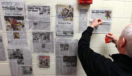Jerry York added another tear sheet to the wall outside the locker room.